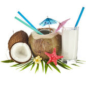 Coconut drink with a straw and palm leaf — Stock Photo