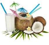Coconut drink with a straw and palm leaf — Stok fotoğraf