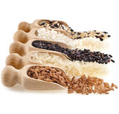 Wooden scoops with different rice types — Stock Photo