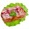 Bacon Slices stack in green leaves lettuce — Stock Photo #42051327
