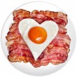 Fried bacon with egg in shape of heart — Stock Photo #42051725