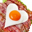 Fried egg in shape of heart — Stock Photo
