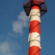 Tower pipe with smoke against blue sky — Stock Photo #42052121