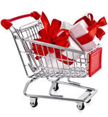Shopping basket cart with gift boxes — Stock Photo