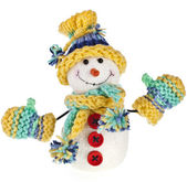 Happy snowman in knitted hat and scarf and mittens — Stock Photo