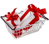 Shopping hand basket with holyday gift wrap boxes — Stock Photo