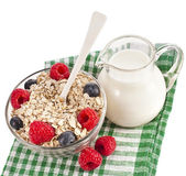 Oat flake in a bowl with a fresh berries and jug of milk — Stock Photo