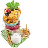 Border of corn flakes with fresh berries, milk, honey — Stock Photo