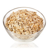 Oat flake in glass bowl close up — Stock Photo