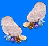 Pair trace feet made of natural colorful raw gem-stones — Stock Photo