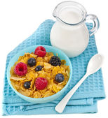 Corn flakes with fresh berries and carafe milk — Stock Photo