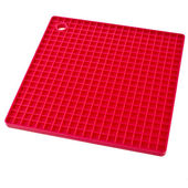 Red silicone place mat — Stock Photo