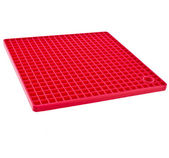 Red Kitchen silicone place mat — Stock Photo