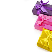 Colorful gift boxes with bows — Stock Photo