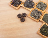 Set of dry tea in spoons — Stockfoto