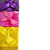 Colorful gift boxes wrapped ribbon bows — Stock Photo