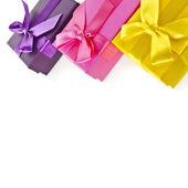 Colorful gift boxes wrapped ribbon bows — Stockfoto