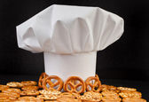 Chef Hat and pretzels — Stock Photo