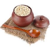 Barley pearl porridge in a clay pot — Stock Photo