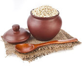 Barley pearl porridge in a clay pot — Stock Photo