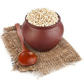 Pearl barley porridge in a clay pot — Stock Photo