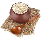 Pearl barley porridge in a clay pot — Stock Photo