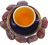 Black coffee with dates — Stock Photo