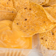 Nachos chips with cheese sauce — Stock Photo #50791963