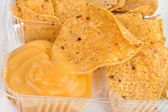 Nachos chips with cheese sauce — Stock Photo