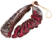 Dried solid sausages sudzhuk — Stock Photo