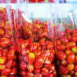 Fresh ripe cherry tomatoes in the market — Stock Photo