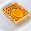 Waffle topped with egg yolk. — Stock Photo