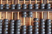 Chinese old wooden abacus. — Stock Photo
