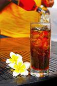 Mug fresh beer and frangipani. — Stock Photo
