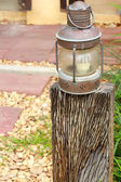 Lighting lamp on a wooden pole. — Стоковое фото