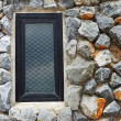 Window on the stone wall — Stock Photo