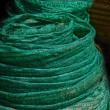 Stock Photo: Green fabric rolls.