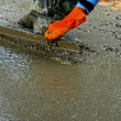 Stock Photo: Pouring concrete mix for road construction workers.