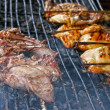 Grilling chicken and Pork roast on the stove — Stock Photo