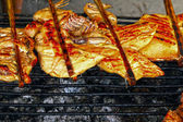 Grilling chicken on the stove — Stock Photo