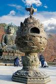 Large bronze lantern front the buddha statue Seoraksan Korea. — Stock Photo