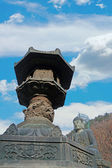 Large bronze lantern front the buddha statue Seoraksan Korea. — Stockfoto