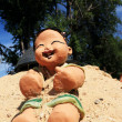 Baby Doll statue on the sand. — Stock Photo
