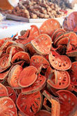 Slices of dried bael fruit at market — Stock Photo