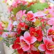 Pink beautiful artificial flowers — Stock Photo #38325067