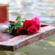 Stock Photo: Red rose placed on the bow.