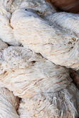 Hand made of raw silk — Stock Photo