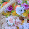 Stock Photo: Headband rose artificial flowers.
