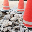 Stock Photo: Traffic cones on damaged roads