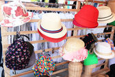 Hats are stacked for sale at the market — Stock Photo